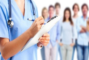 Medical person with note pad with people in the background